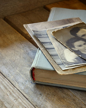 antique photos and old book on wooden ta