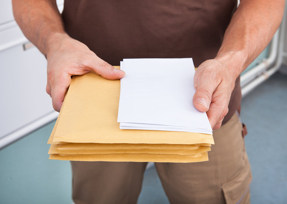 Close-up Photo Of Mature Postman Holding