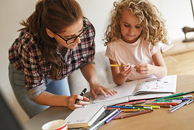 Teacher and child coloring