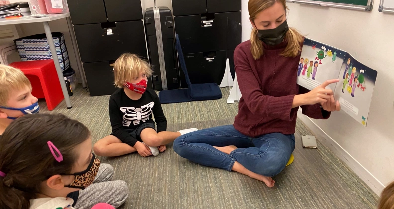 student reading to patients