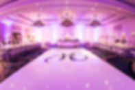 pipe and drape seemless white dance floor uplighting tufted round bar