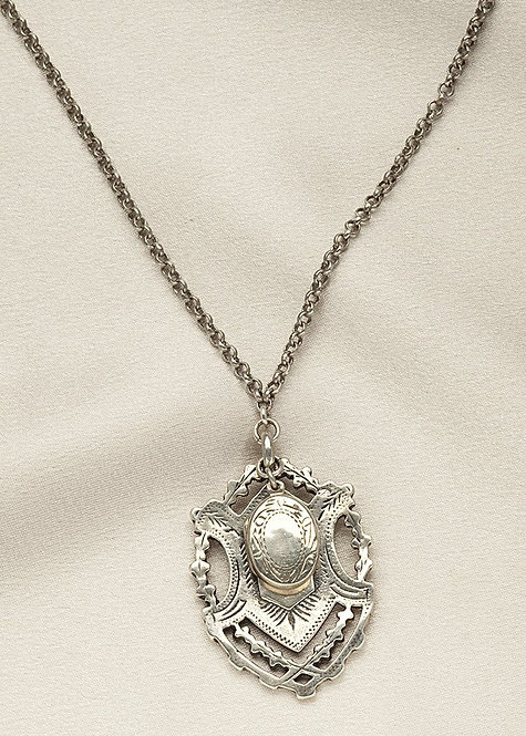All sterling silver, antique medal from England, with sterling locket, and chain