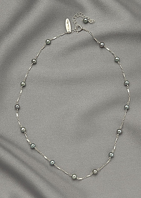 Sea foam pearls joined with a unique sterling silver chain