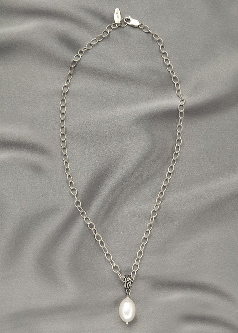All sterling silver, with a beautiful pearl drop