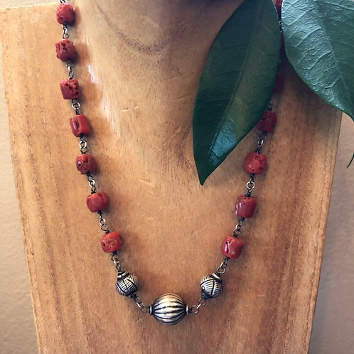 Antique coral with oxidized and bright sterling silver wire wrap