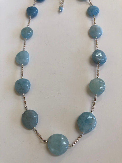 Aquamarine disks include sterling silver chain