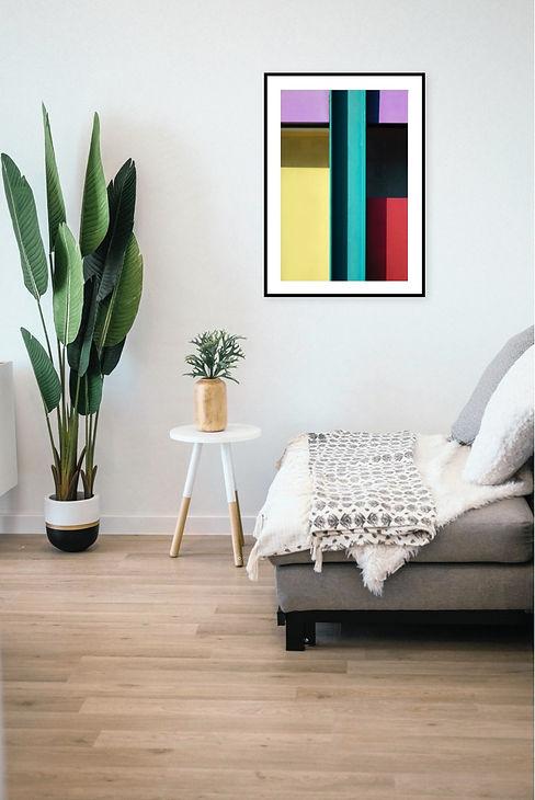 Raum mit Sofa und Pflanze und einem Bild von Guido Klumpe