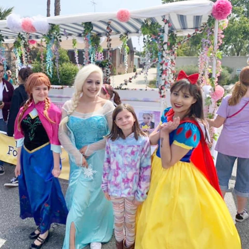 Princesses posing with fans.