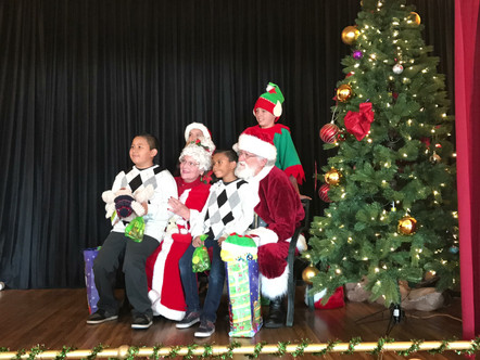 Families receive gifts from Santa and his Elves!