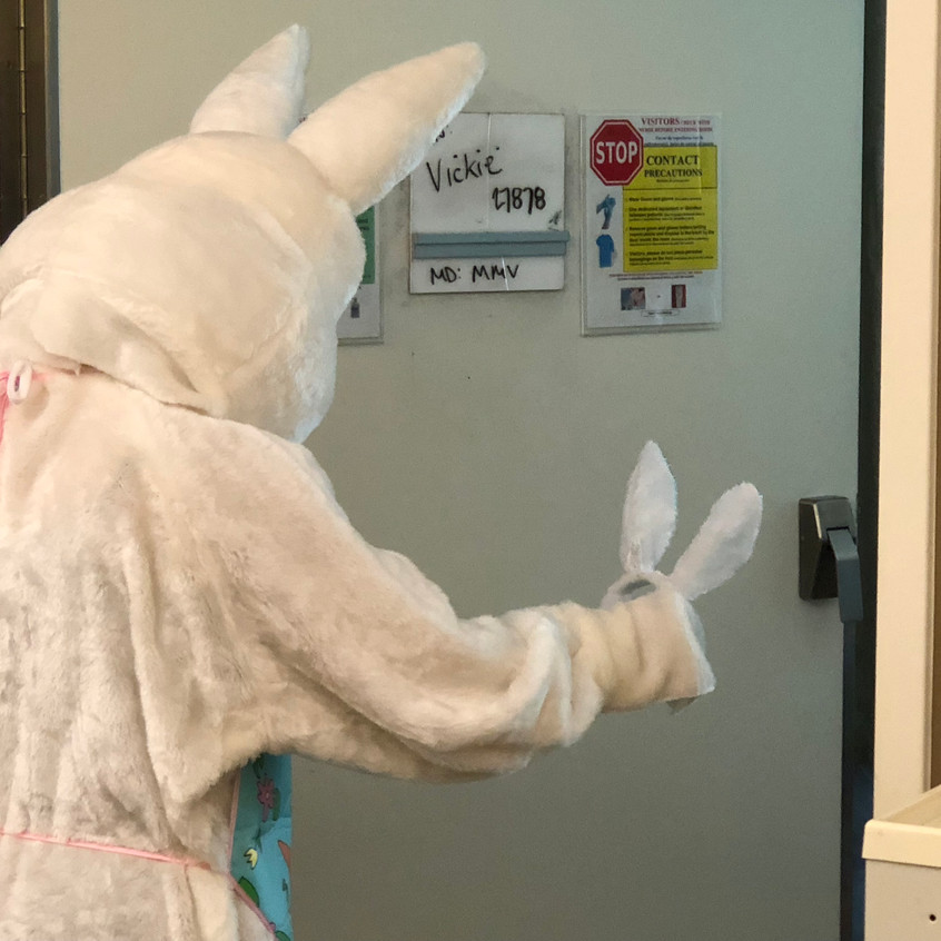 The Easter Bunny handing out ears to kids and teens!
