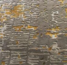 Close up golden runner rug