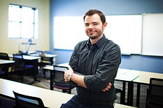 Eric Sprankle, smiling in classroom