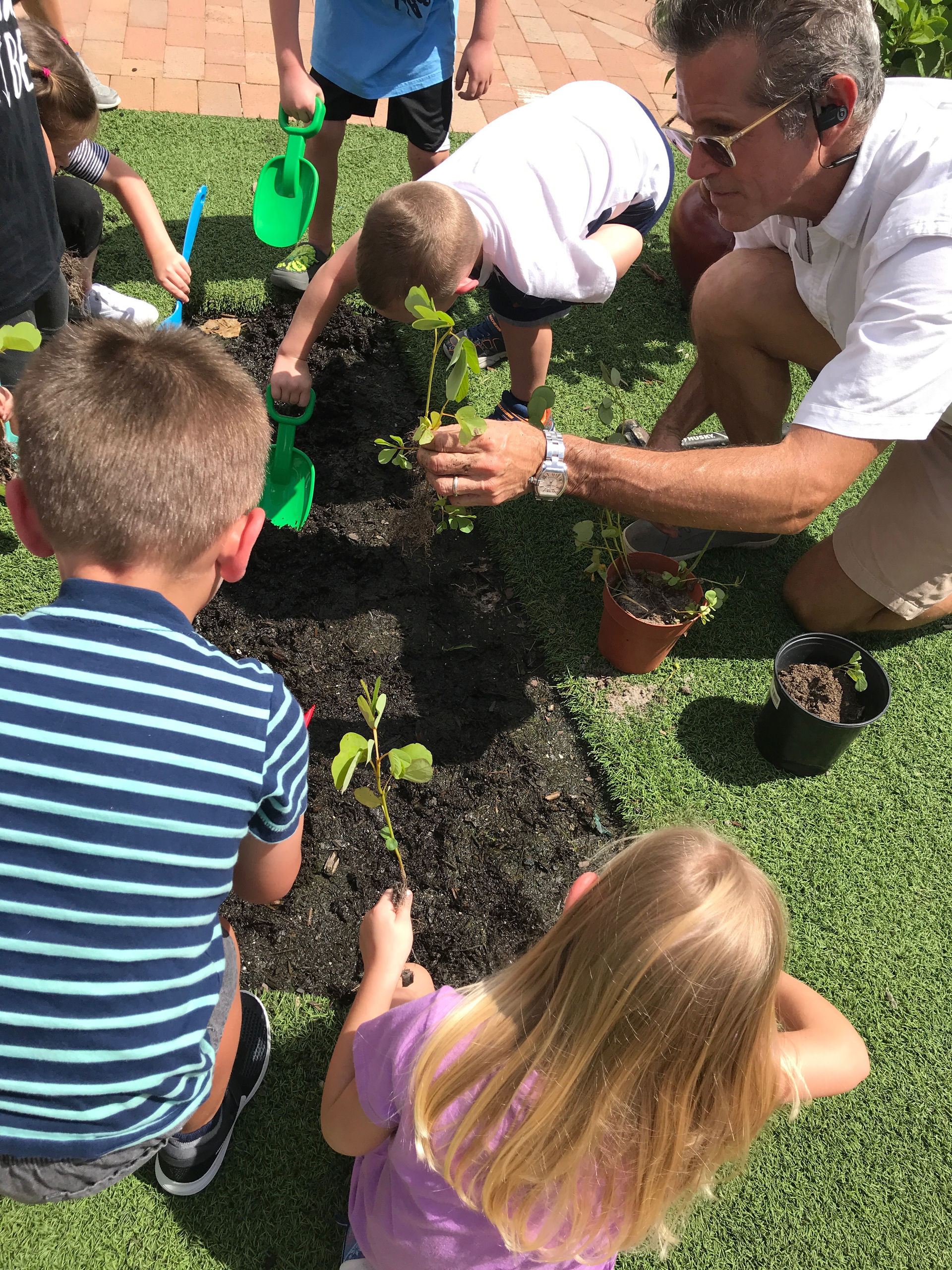 Teaching a planting workshop with a local pre-school