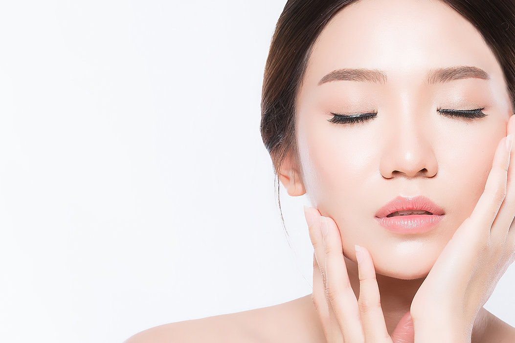 Woman feeling effects of product on her face