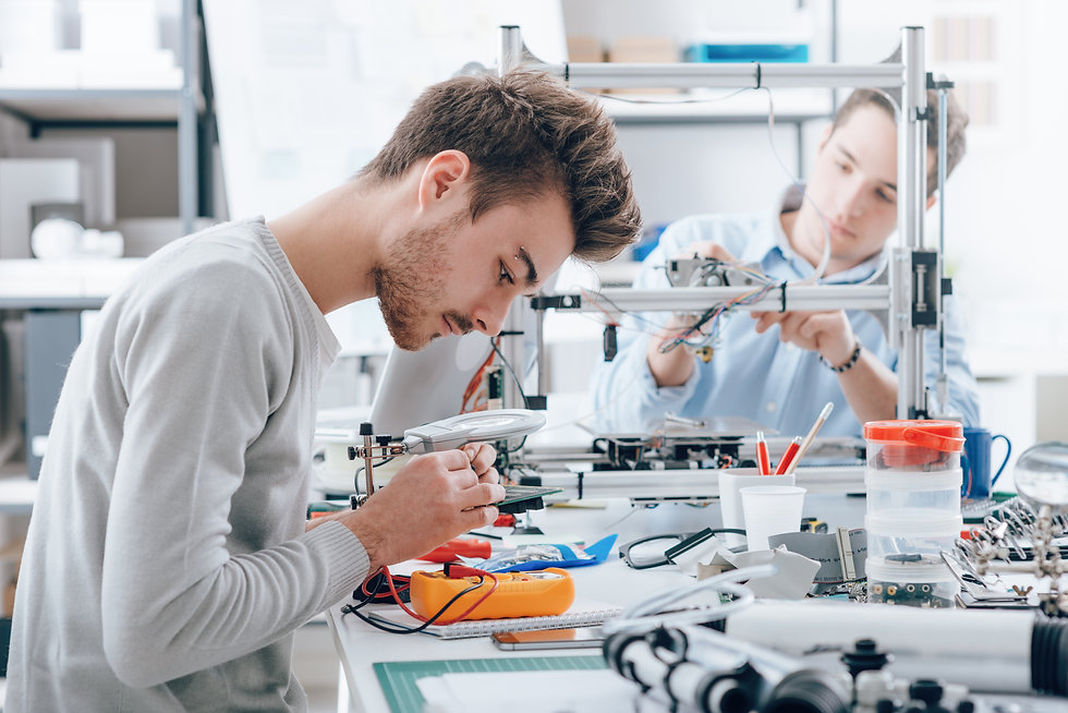Engineering students working in the lab,