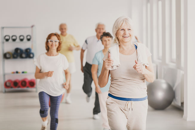 Smiling senior fitness instruct exercisi