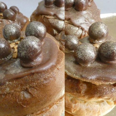 Choux, croustillants aux gavottes et pralin, crème pâtissière au chocolat Valrhona, bille fondante et paillettes d'or.
