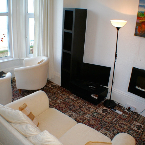 Apartment 5 lounge with bay window sea views