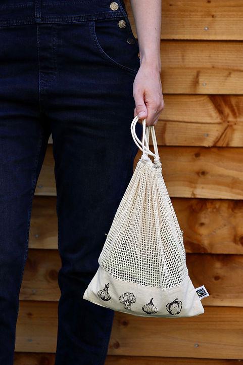 Small Veg Grocery Bag against wood cladding.jpg