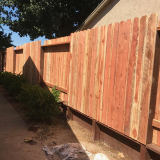 dog ear fence with retainer wall.jpg