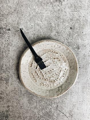 simple white garlic scraper