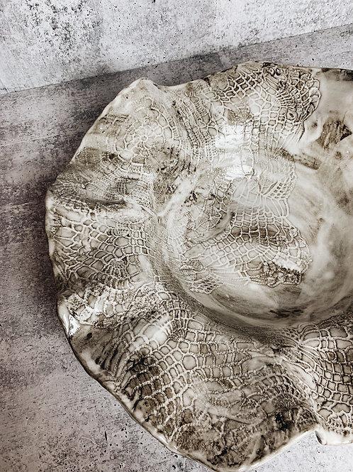 large wavy white wash bowl