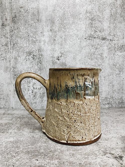 savanna breeze carved water pitcher