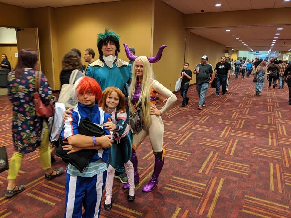 Family cosplaying as heroes from Boku No Hero (My Hero Academia). Front to back: Shoto Todoroki, Ochaco Uraraka/Uravity, Yu Takeyama/Mount Lady, and Izuku Midoriya/Deku