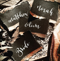 black and gold place cards