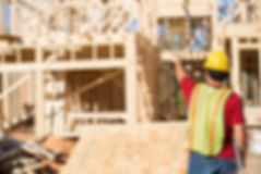Construction worker pointing towards a construction site