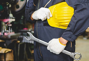 factory-engineer-holding-a-hard-hat-and-