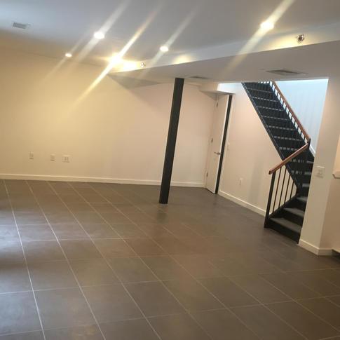 Cellar Floor Apartment Renovation by CN Coterie