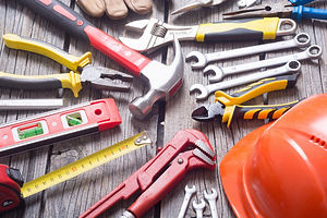 Set of tools on wooden background ..jpg