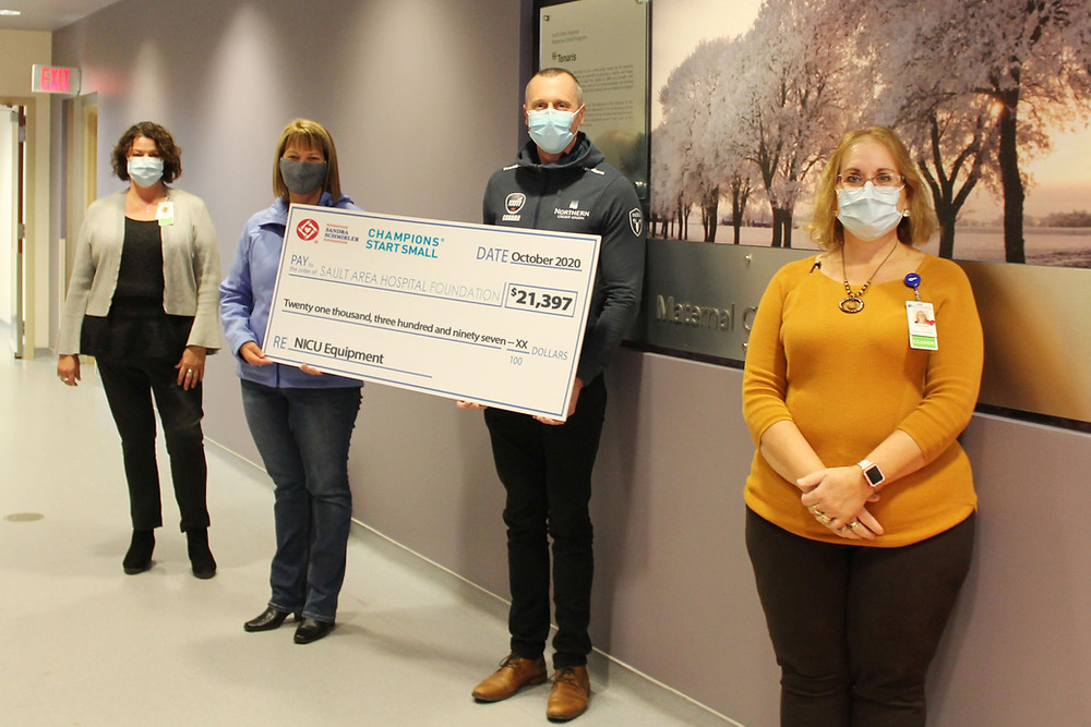 Representatives of Sandra Schmirler Foundation present a cheque for $21,397 to Sault Area Hospital Foundation. Left to right: Teresa Martone, Executive Director of SAH Foundation; Erin Brown, Sandra Schmirler Foundation Donor; E.J. Harnden, Team Jacobs; and Kierston Mirion, Director of our Maternal/Child Health Program.