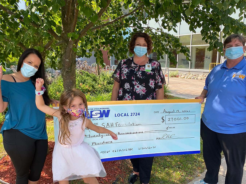 The excitement for this gift couldn't be contained! USW Local 2724 presents SAHF with a cheque for $27,001 to purchase a Microtome for the Laboratory. (Pictured Left to Right: Melissa McMaster of USW Local 2724, Melissa's daughter, Teresa Martone of Sault Area Hospital Foundation, and Rebecca McCracken of USW Local 2724)