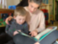 great pic MS girl reading to pk boy.jpg
