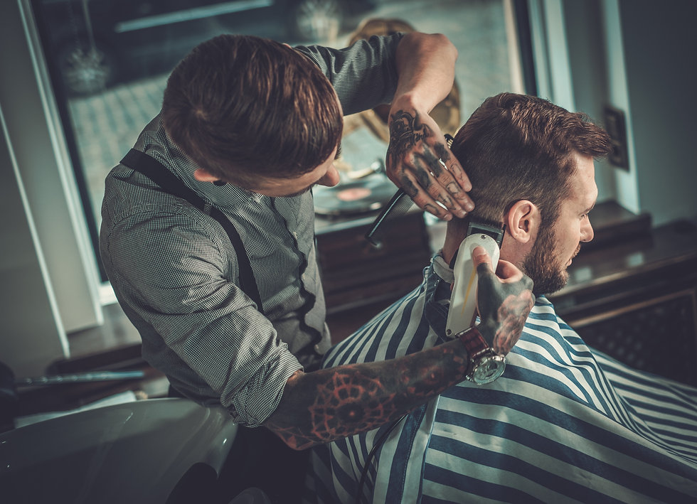 Confident man visiting hairstylist in barber shop..jpg