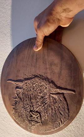 Poesie in Lehm auf Holz