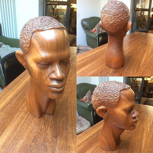 Wood carved african head