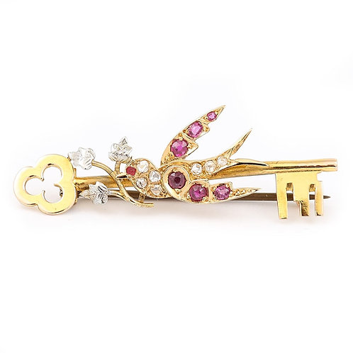 Victorian 15 Karat Yellow Gold Key with a Ruby and Diamond Swallow Brooch