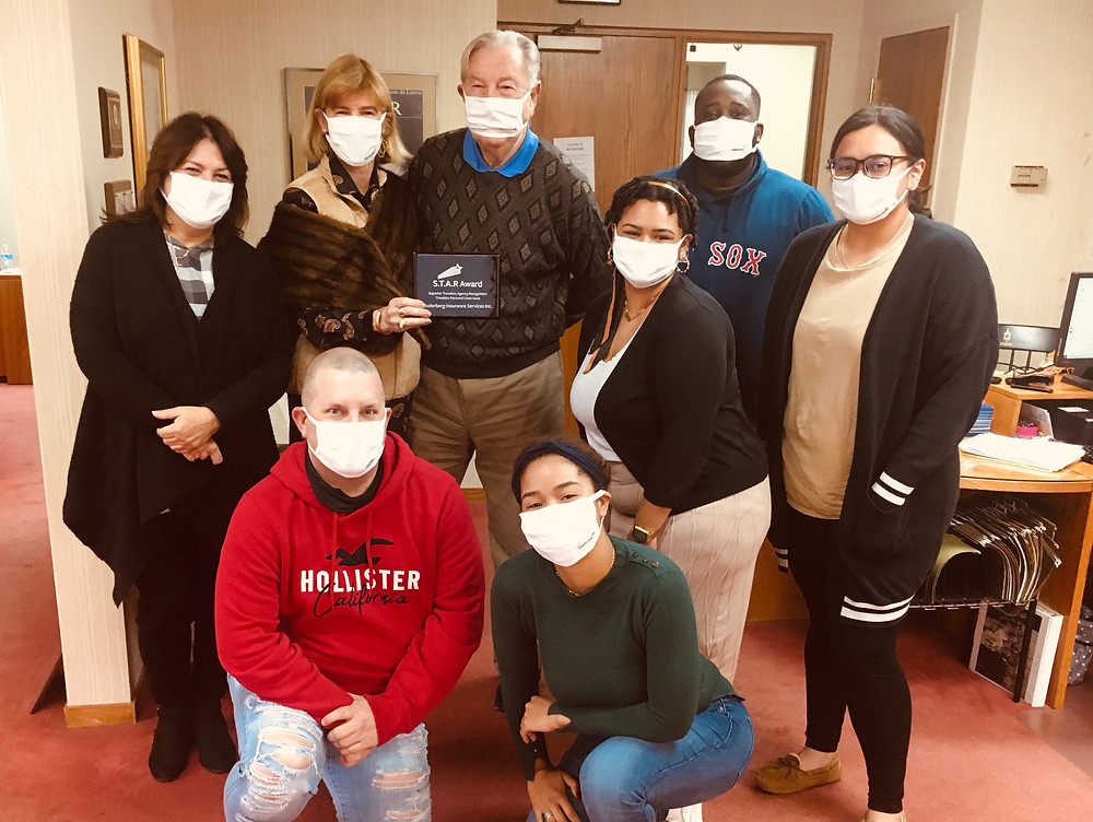 Soderberg Staff wearing new Travelers masks