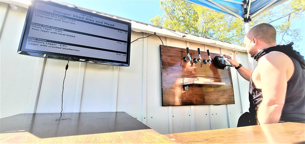 outdoor beer bar with tv screen