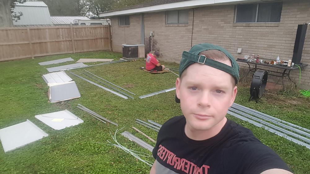 man building a backyard shed