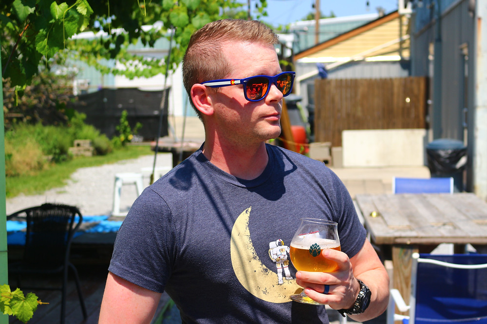 Man drinking craft beer at a local brewery