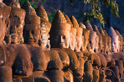 buddha-head-statues-angkor-wat-temple-carson-ganci