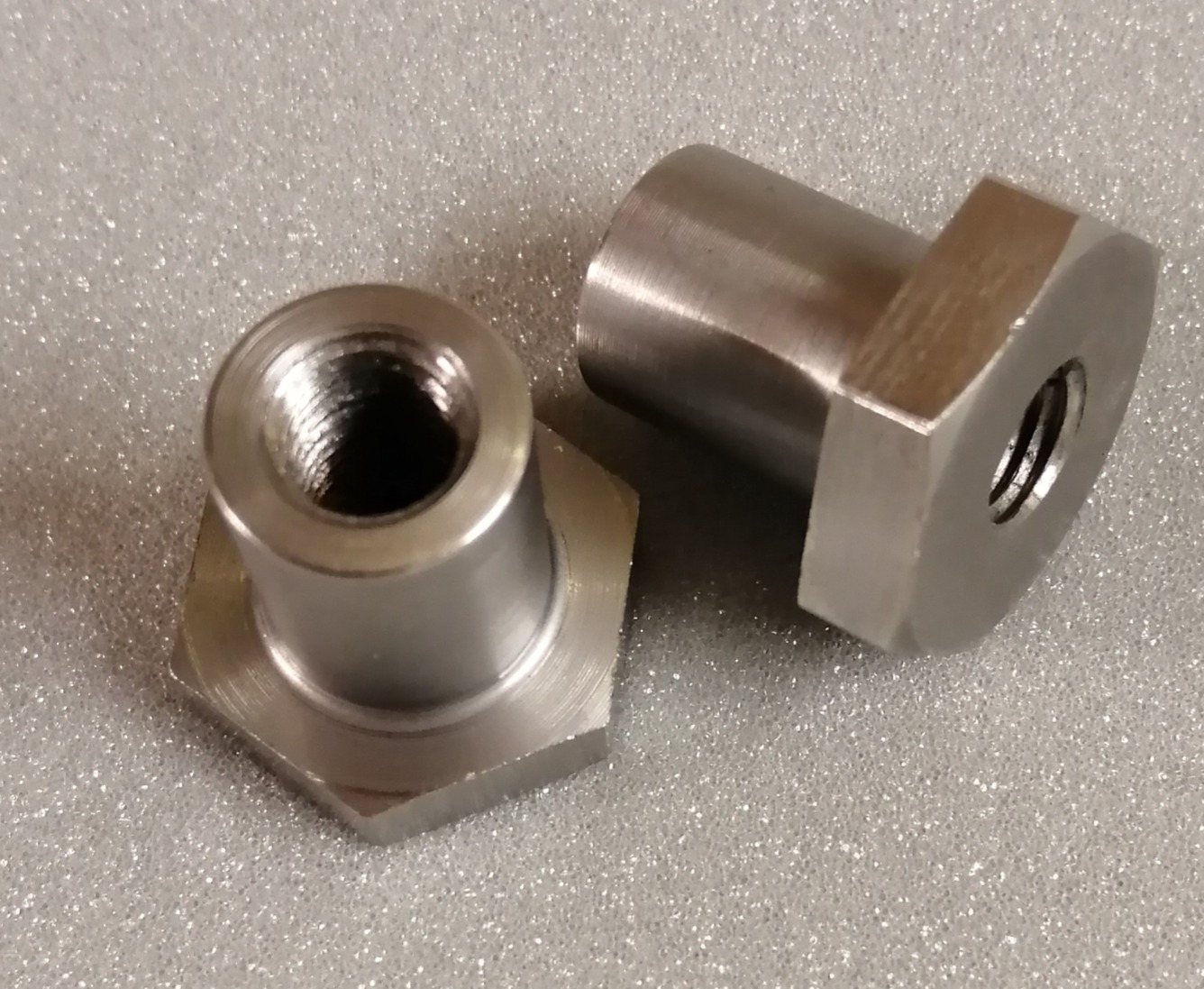 Threaded hex bush boss tubing insert