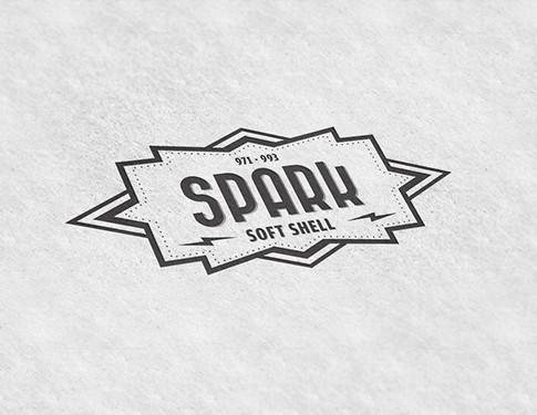 Spark Jacket Logo NEW.jpg