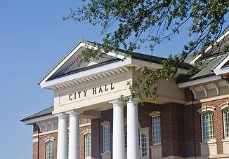 A classic brick town city hall through t