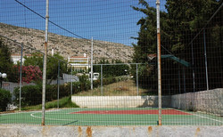 The tennis court of the villa