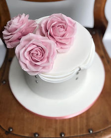 Iced finish with sugar roses.jpg